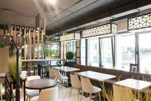 interior modern urban restaurant morning sunlight