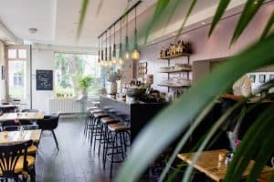 interior shot cafe with chairs near bar with wooden tables 181624 1669